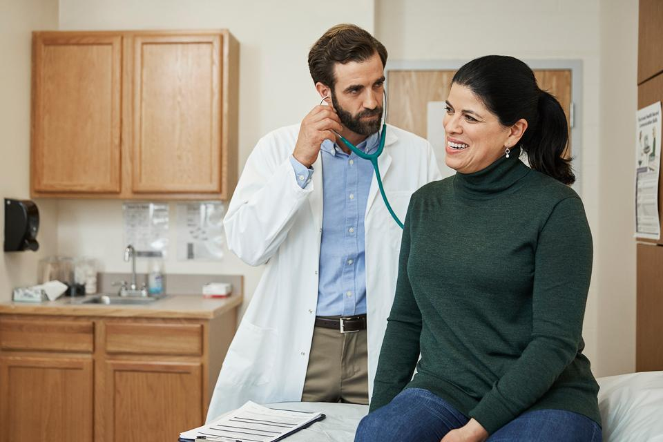 Woman discussing heart disease with her doctor
