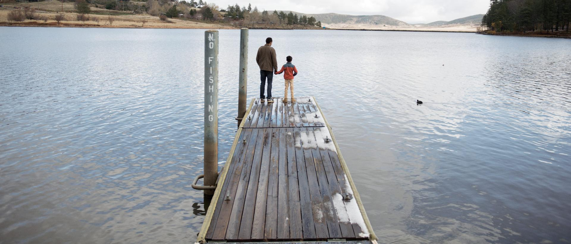 Dad and son on dock