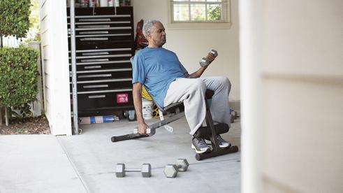Blue Cross Blue Shield member exercising at home to stay fit during the coronavirus outbreak