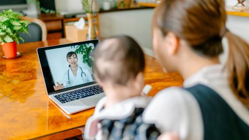 Mom and baby using free telehealth services from Blue KC