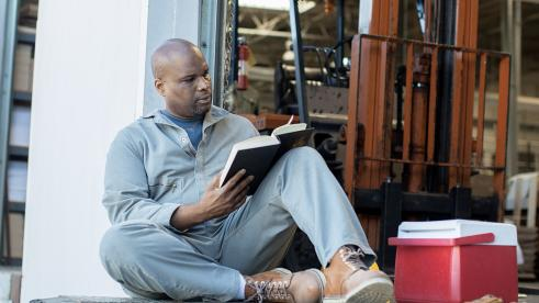 Man reading a book on his lunch break