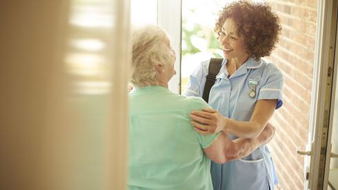Healthcare worker visiting a patient