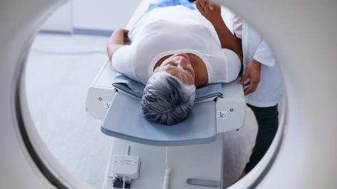 man on MRI table in front of MRI machine
