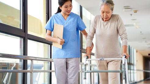 Patient in rehab improving their knee and hip replacement