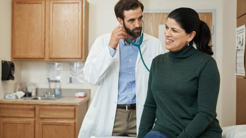Woman visiting her doctor to discuss heart disease