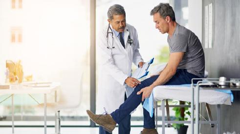 Doctor checking Patients Knee