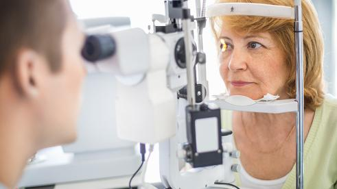Woman receiving an eye examination at the optometrist's office