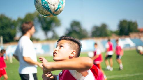 A child playing soccer in the US
