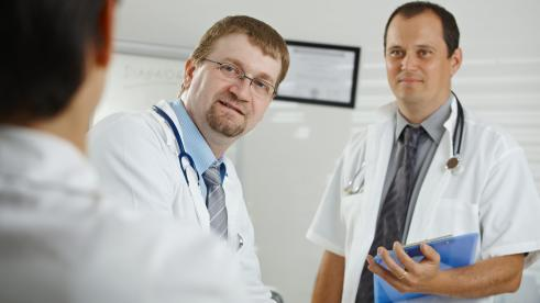 Two doctors discussing their diagnosis with a patient