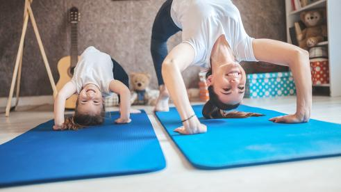 Family doing yoga exercises at home