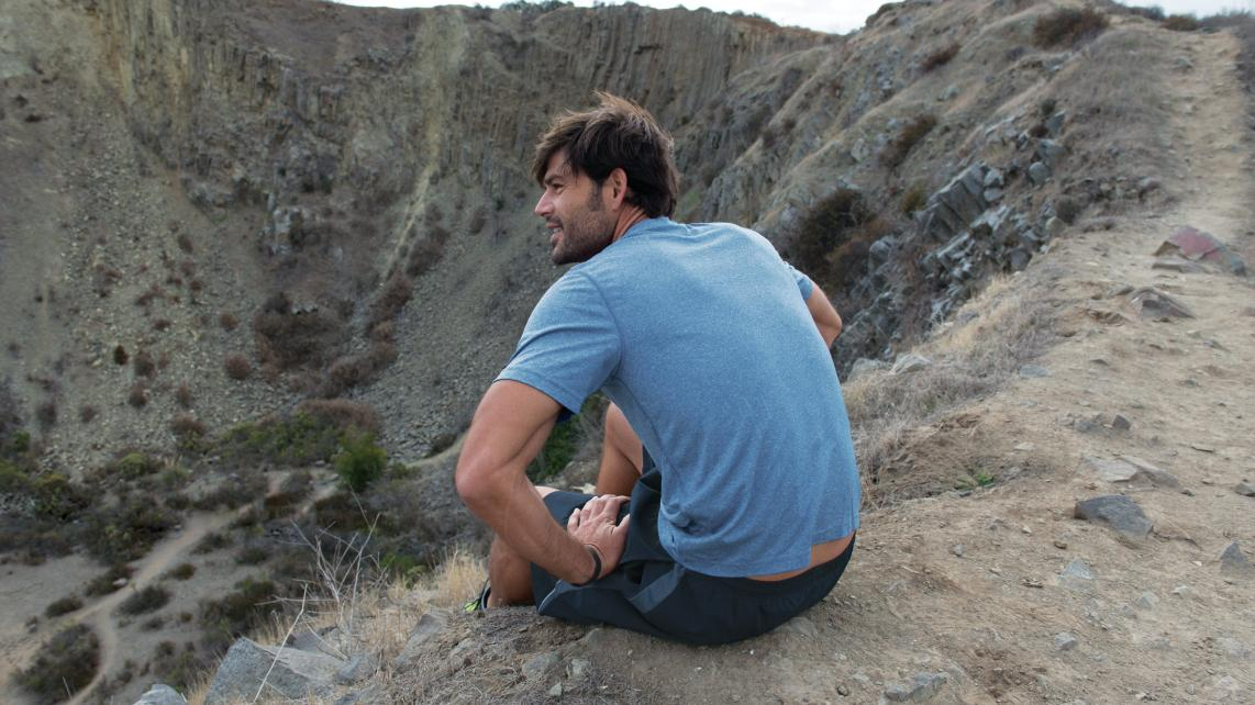 Man sitting at a canyon