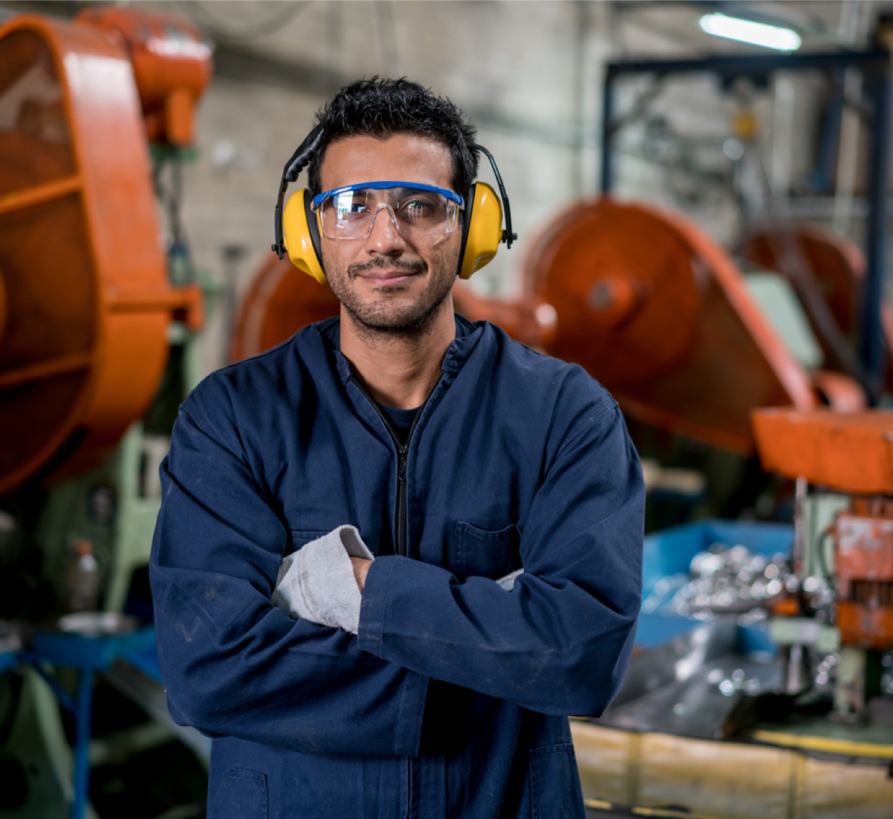 Man wearing goggles and sound ear muffs