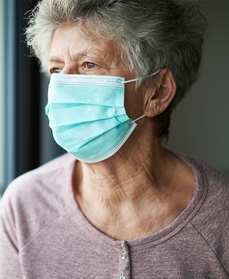 Elderly woman wearing a face mask