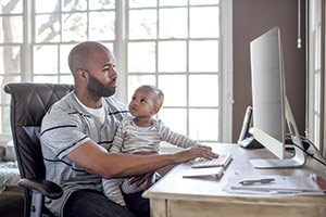 Father and son on a computer